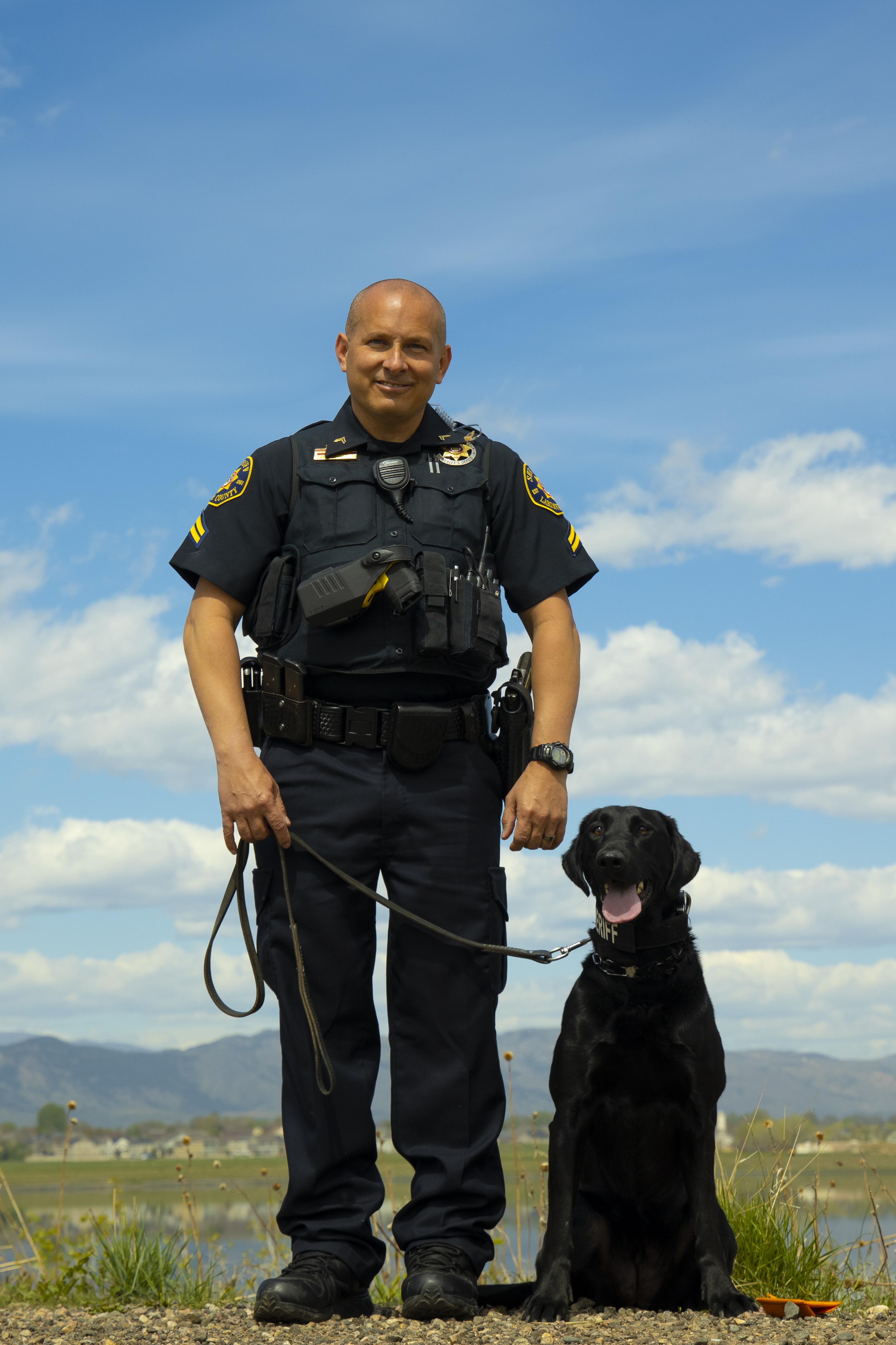Image 4: Corporal Joe Pugliese and K9 Raven (Black Lab)