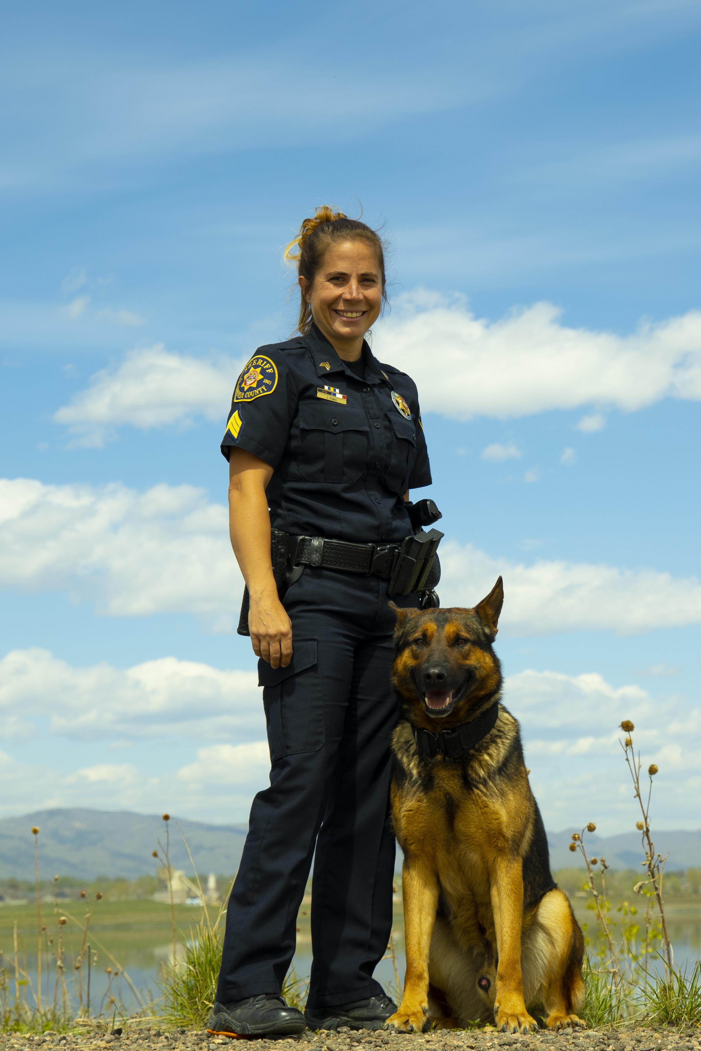 Image 1: Sergeant Jackie Stimac and K9 Negan (German Shepherd / Belgian Malinois Mix)