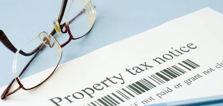 Property tax statements and new postcards in mail