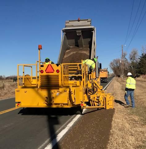 Shouldering Machine repairing roadside