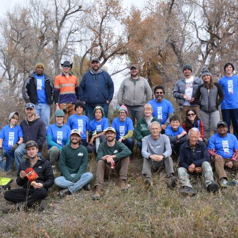 Group of volunteers posing for photo after completing a volunteer project.