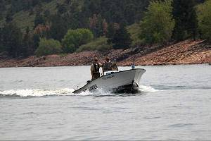 Larimer County Boat Ranger patrol boat moving through the water.